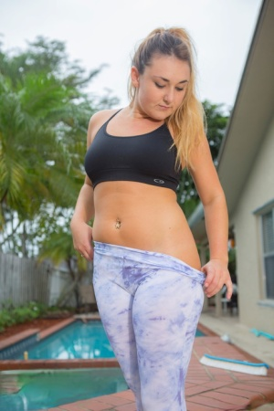 Chubby girl Lennox James peels of sports bra and spandex pants to model naked
