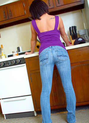 Brunette girl unveils big naturals in the kitchen after stripping to panties