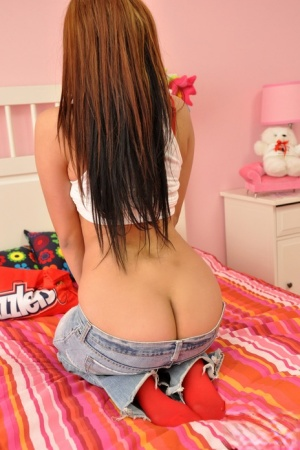 Teen amateur Cindy Cupcakes sports long red hair while exposing her ass 21836914