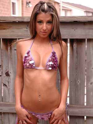 Thin girl Missy makes her modeling debut in the yard wearing a sequin bikini