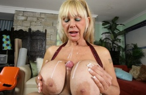 Older blonde woman pleasures a large dick with oral sex and giant boobs