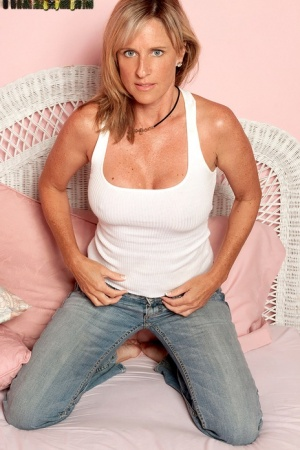 Middle-aged lady in denim jeans tries her hand at being a nude model
