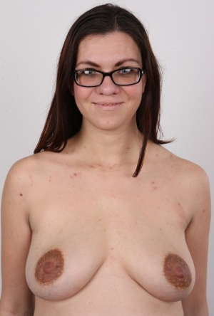Glasses clad Andela strips to show off her sexy pregnant body naked