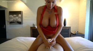 Blonde housewife with huge tits jerks off her mans cock in a red dress