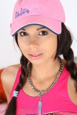 Cute teen Kiki 18 sports pigtails and a ballcap while having sex on a bed 31515767