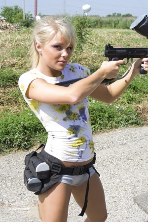 Amateur female Meet Madden plays paintball in just her white panties and shirt