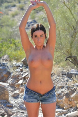 Flexible babe Cecilia strips her jean shorts off and dildos her ass outdoors
