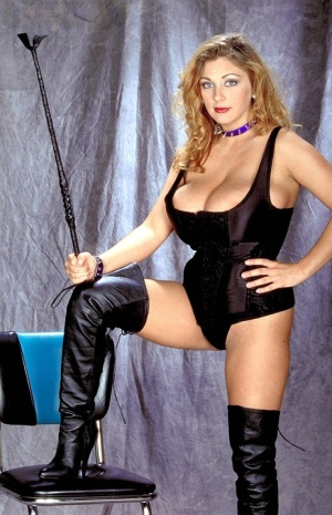 Solo model Autumn Jade lets a large breast escape from her outfit in boots 60822618