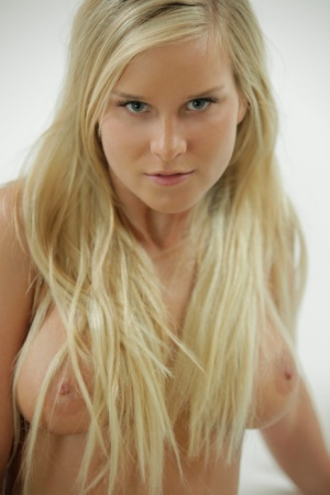 Blonde doll Mary slowly touches her magical tits and pussy