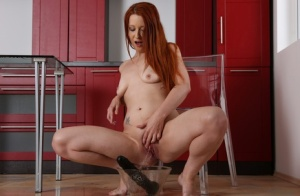 Kinky redhead Isabella Lui drinks her own pee and anal and vaginal dildoing
