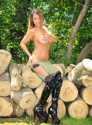 Amateur model Nikki Sims goes topless in latex OTK boots by cut firewood