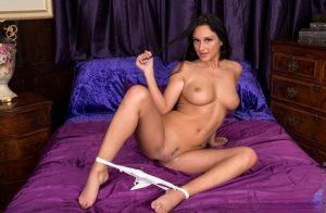 Brunette housewife Cassie Clarke showcases her landing strip pussy once naked