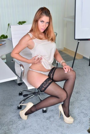 Business lady Ani Blackfox folds back her labia lips after stripping in office