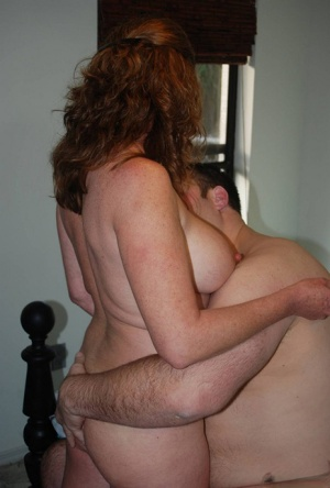 Horny mature Dee Delmar gets on her knees naked to give a handjob 88764197