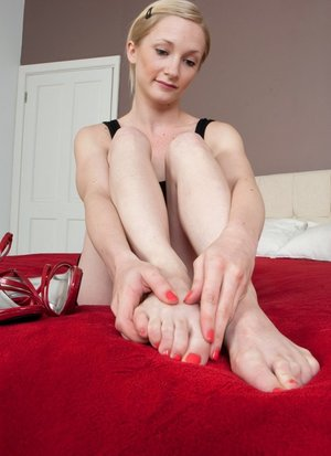 Blonde tease Lil Chloe takes off her heels to flaunt sexy feet  lick her toes