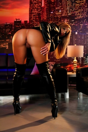 Hot blond Olivia Austin strikes great poses in a leather jacket and long boots