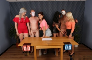 Two women jerking off man wearing a mask during CFNM action