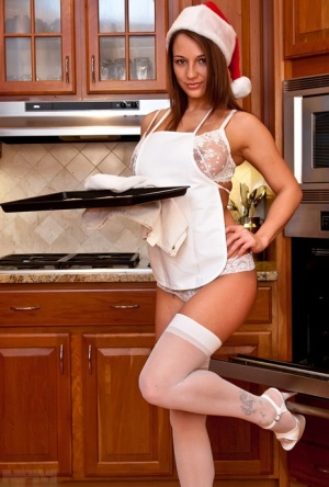 Amateur chick Nikki Sims covers her naked nipples with whip cream at Xmas