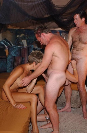 Hot mature mom enjoys a night of uninhibited cock sucking with swinger friends