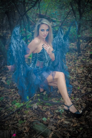 Fairy cosplay girl Nikki Sims doffs her wings and wisp to pose in a thong