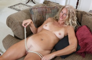 Older blonde housewife from the USA strips naked before toying her horny pussy