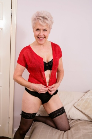 Horny mature granny wears black stockings to masturbate her shaved pussy 20706570