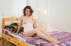 Russian lady Princess Mustang takes a vibrator to her bush once she is naked