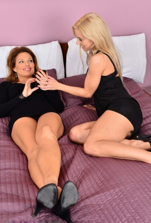Lesbian women Nesty and Szilvia remove black dresses before licking pussies
