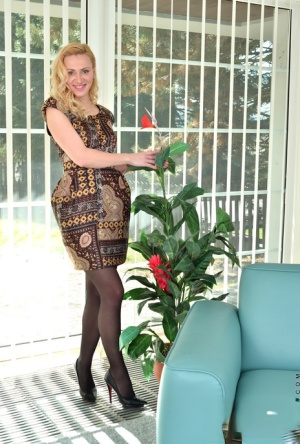 Blonde houswife Affina Kisser shows the pink of her twat in black stockings