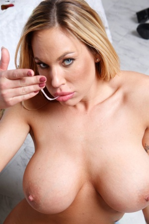 Busty blonde chick plays with jizz after fucking a big black dick