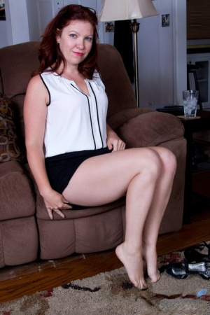 Older housewife Kimberlee Cline downs a stiff drink and takes off her clothes
