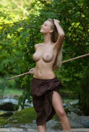 Smiley blonde hottie Carisha sheds sexy skirt to net fish in the river naked