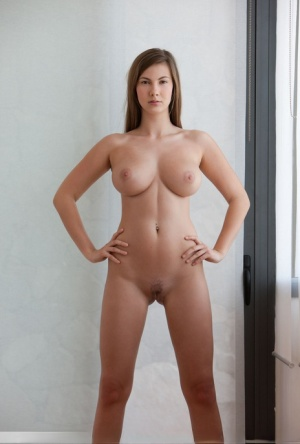 Busty beauty Josephine crosses her long legs while modelling totally naked