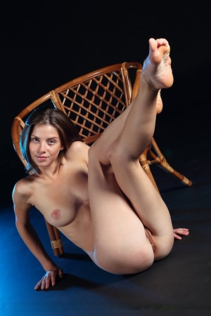 Brazen young brunette Danica sheds her threads to spread naked on her knees