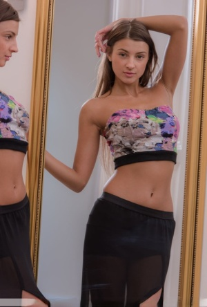 Solo model Maria Rya glances in a mirror before getting totally naked 66574613