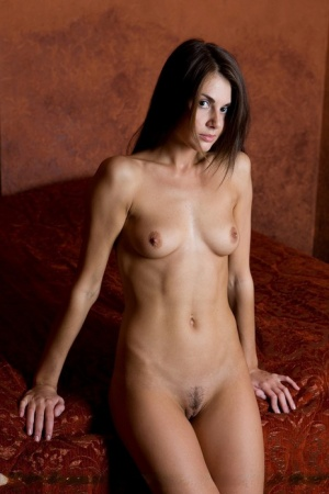 Confident tease Alannis reveals her sexy small tits and toned petite ass nude