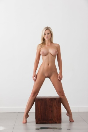 Hot blonde Miela strikes great nude poses during solo action on a wooden box