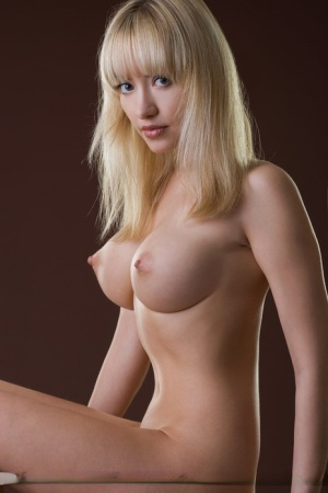 Big titted blonde beauty Lia poses seductively nude showcasing perfect breasts 67805281
