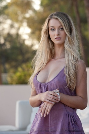 After stripping outdoors hot blonde Carisha models her sexy big tits  ass