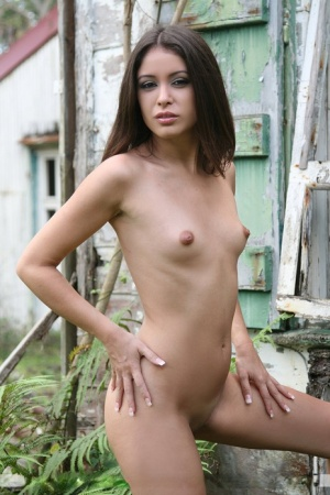 Thin solo girl Angelique models totally naked around an old farm