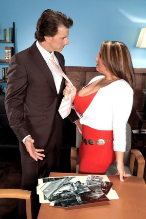 Big titted chick Stephanie Stalls seduces a man in a clingy red dress