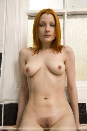 Natural redhead Krissi flaunts her juicy ass before and after taking a bath