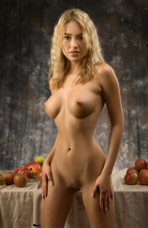 Gorgeous blonde haired Lia with hot ass & firm tits tempts naked with an apple