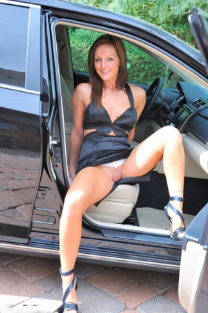Amateur babe in high heels flashing shaved upskirt pussy outdoors
