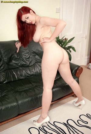Big boobed ginger strips off her see through panties and poses butt naked