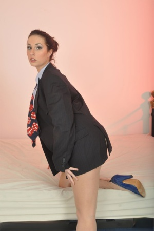 Clothed solo model Paige Turnah struts in a blazer while waving a pistol
