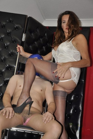 Older lady Nylon Jane dress a man in a bra and hose before a footjob in nylons