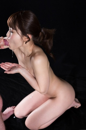 Completely naked Japanese girl spits out a mouthful of cum into her hands