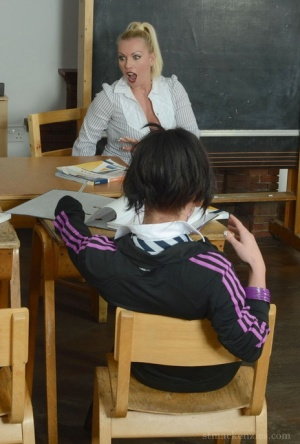 Coeds Billie Evans  Mercedes Marston are forced to strip by a lesbian teacher