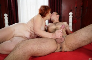 Fat nan with red hair opens her mouth for jizz after fucking her young lover